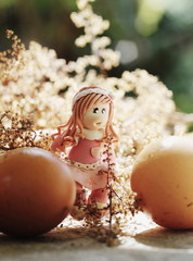 easter girl walking among eggs