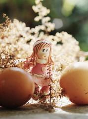 easter girl walking among eggs