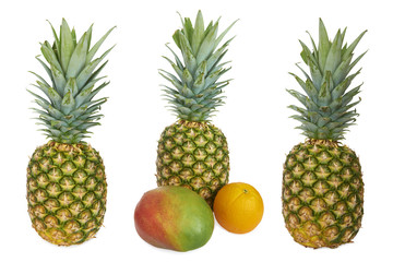 Set of Ripe pineapple, mango and orange. Isolated on white