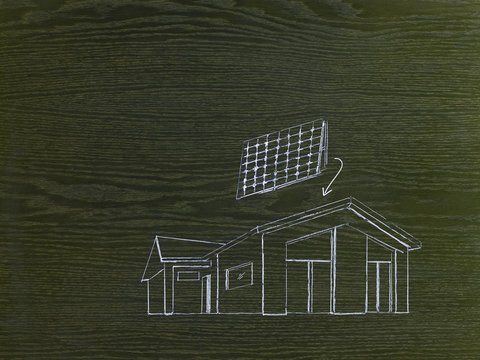 A line drawing image on grained wood. A green building project, a house with solar panels for the roof.