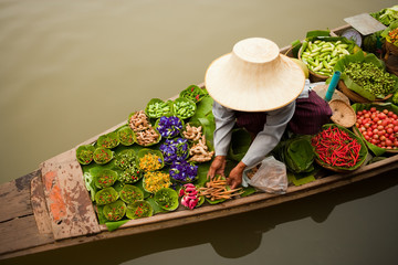 Floating markets are a common tradition throughout Southeast Asia. Bangkok, Thailand.