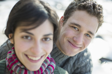 Close up of two people, man and woman, a couple outdoors on a winter day.