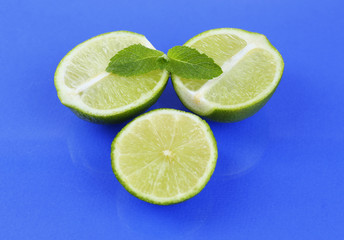 Fresh limes, on blue background