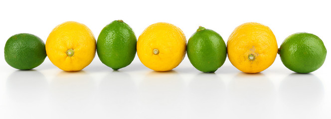 Lemons and limes, isolated on white