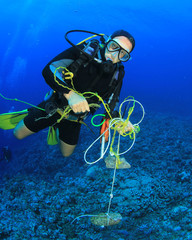Scuba diver cleans up underwater rubbish