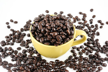 Coffee cup and beans on white-gray background