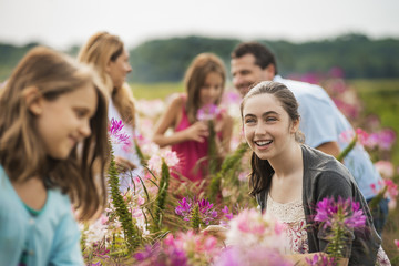 A group of people among the flowers at an organic Flower Farm.
