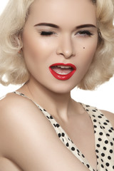 Sexy woman with vintage make-up & hairstyle. Winking pin-up girl