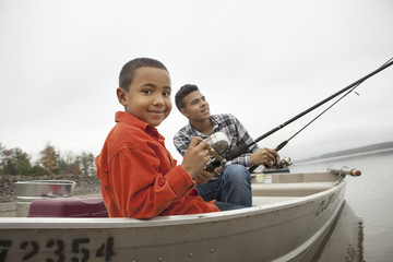A day out at Ashokan lake. Two boys fishing from a boat.
