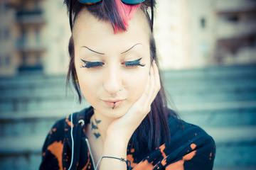 young beautiful punk dark girl listening music