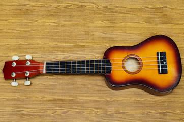 ukulele on wood texture