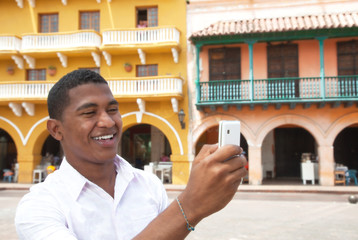 Tourist taking a picture in a colonial town