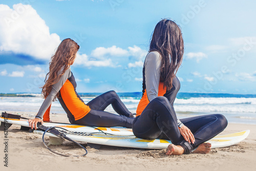 surfer girls relaxing near the ocean stockfotos und. Black Bedroom Furniture Sets. Home Design Ideas