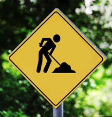Yellow label with working man pictogram