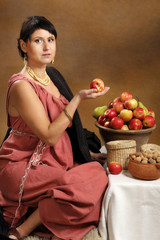 Young Romana with basket full of fruits.