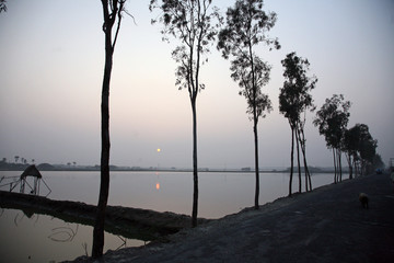 Sunset on holiest river in India. Ganges delta in Sundarbans