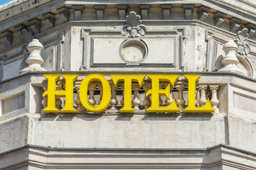 Yellow Hotel Sign Close Up On Building
