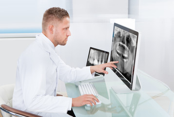 Doctor or radiologist looking at an x-ray online