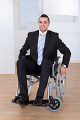 Disabled Businessman In Wheelchair At Office