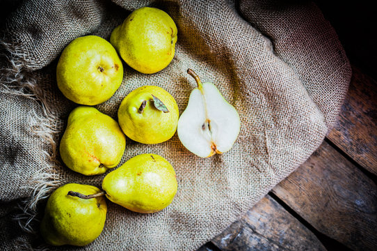 Pears on rustic wooden background