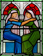 Fototapete - Visitation: Mary meets Elizabeth. In stained glass