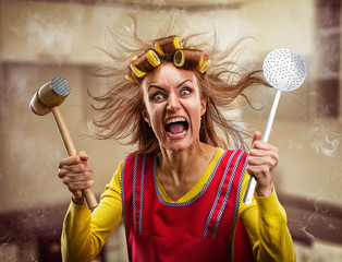 Crazy housewife with hammer on her hand