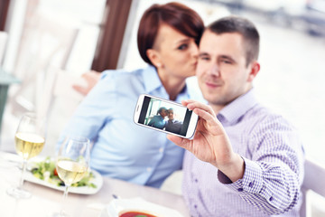Kiss in a restaurant