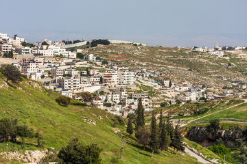 Palestinian town on suburb of Jerusalem.