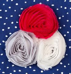 Three colored fabric flower