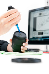 woman engineer repairing camera lens