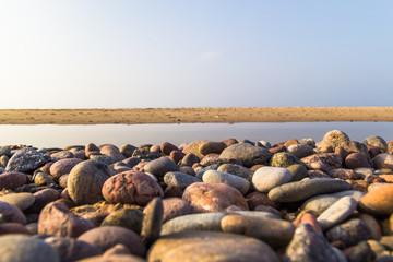 Baltic beach stones blue sky