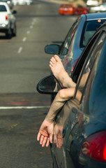 Man Driver Hangs Foot and Hand out Car Window