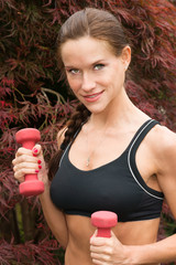 Young Adult Beautiful Brunette Woman Running Weights in Park