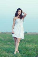 Beautiful girl walking on the meadow