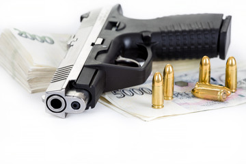 gun with bullet and czech banknotes