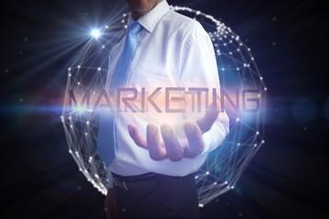 Businessman presenting the word marketing