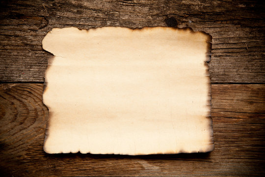 Horizontal old paper on wooden background