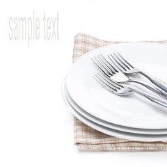 plates and forks - utensils for serving on napkin, isolated