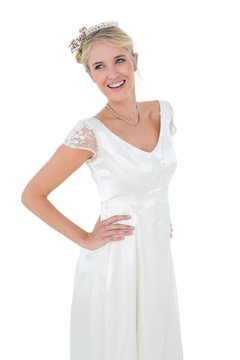 Woman in wedding dress against white background