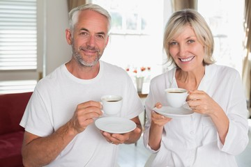 Portrait of smiling mature couple with coffee cups