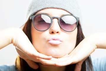 Portrait of hipster teenage girl giving kiss