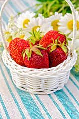 Strawberries in a basket on napkin