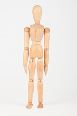 Plain wood mannequin stand upright isolated on white