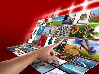 Hand on digital photo display