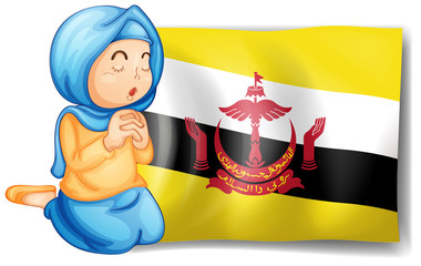 A lady near the flag of Brunei