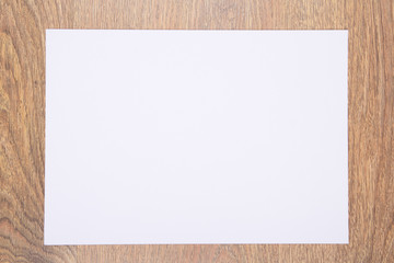blank sheet of paper on wooden table
