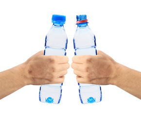 Human hands holding bottles of water isolated on white