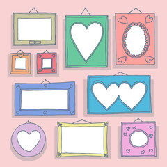 Set of hand drawn picture frames on wall.