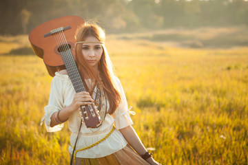 Hippie woman walking in golden field