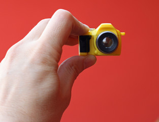 photographer while on a self-timer with a small toy camera